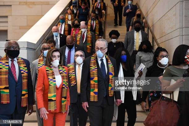 Speaker of the House Nancy Pelosi DCalif and other members of Congress gather at the Emancipation Hall to observe a moment of silence to honor George...