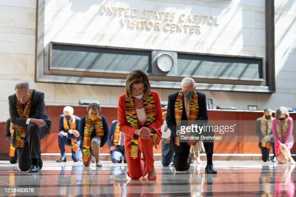 Speaker of the House Nancy Pelosi DCalif and other members of Congress gather at the Emancipation Hall kneel as they take moment of silence to honor...
