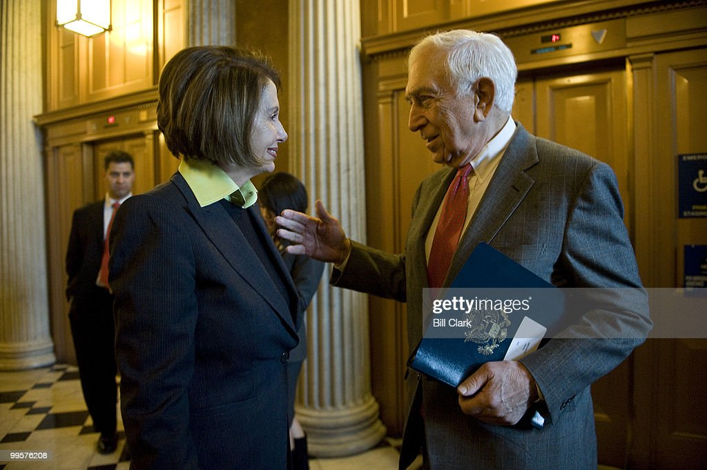 Speaker of the House Nancy Pelosi, D-Calif., and Sen. Frank Lautenberg, D-N.J., greet each other as they pass by outside of the LBJ Room on Wednesday, Dec. 9, 2009. Speaker Pelosi was leaving a reception for Sen. Robert Byrd, while Sen. Lautenberg was on his way in.
