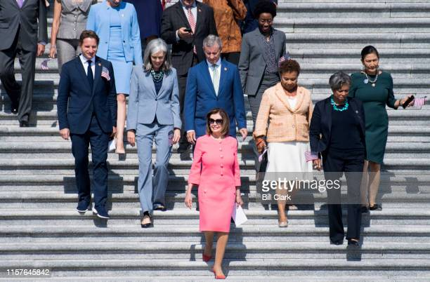 Speaker of the House Nancy Pelosi DCalif leads House Democrats down the House steps to hold a news conference on the first 200 days of the 116th...