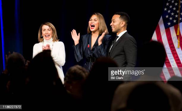 Speaker of the House Nancy Pelosi, D-Calif., model Chrissy Teigen and her husband and singer John Legend stand on stage at the end of the dinner...