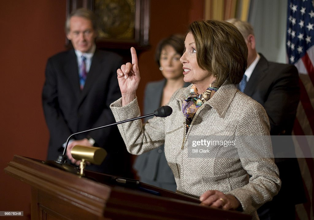 Speaker of the House Nancy Pelosi, D-Calif., points to the clock as she ends her news conference on Monday, Feb. 23, 2009, to discuss their recent Congressional trip to Italy and Afghanistan. Speaker Pelosi was due to be at the White House in 10 minutes.