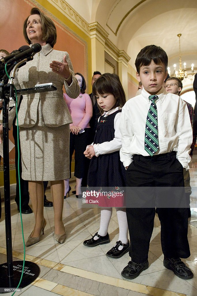Speaker of the House Nancy Pelosi, D-Calif., surrounded by families with chhildren, makes a brief statement about the expected passage of SCHIP legislation later in the day on Wednesday, Feb. 4, 2009.