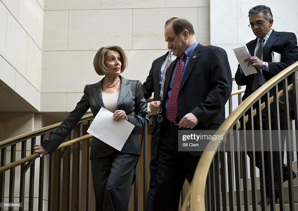 Speaker of the House Nancy Pelosi, D-Calif., talks with Rep. Michael Capuano, D-Mass., as they arrive for the House Democrats' caucus meeting in the Capitol Visitors Center on Tuesday, March 16, 2010.