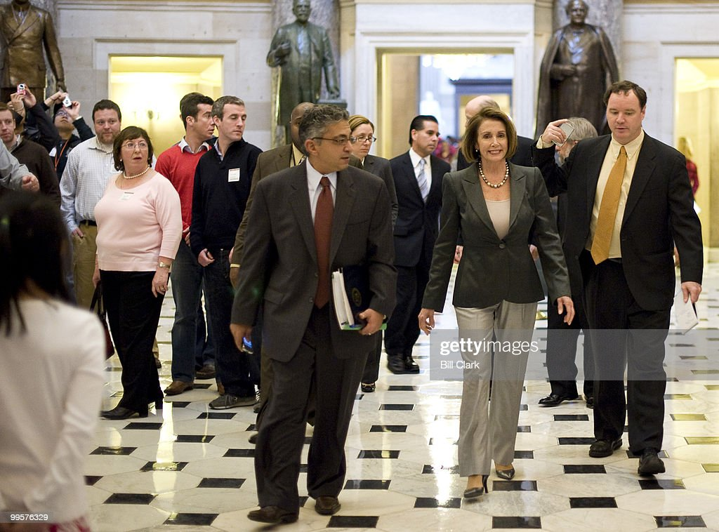 Speaker of the House Nancy Pelosi, D-Calif., walks through Statuary Hall on her way to her weekly news conference in the Capitol on Thursday, Oct. 15, 2009.
