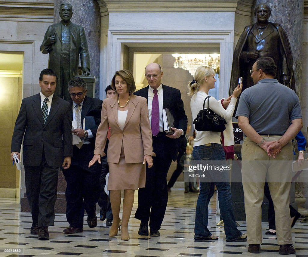 Speaker of the House Nancy Pelosi, D-Calif., walks through Statuary Hall on her way to her weekly news conference on Thursday, Sept. 25, 2008.