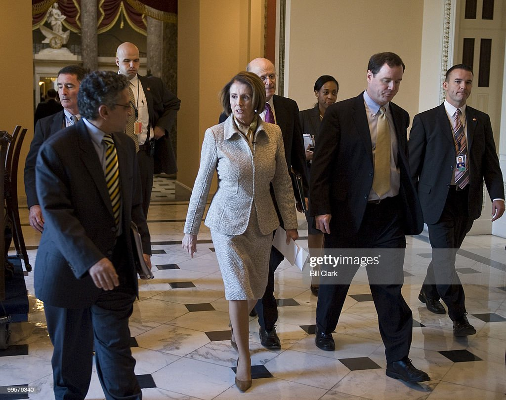 Speaker of the House Nancy Pelosi, D-Calif., walks through Statuary Hall on her way to her weekly news conference in the Capitol on Thursday, Nov. 5, 2009.