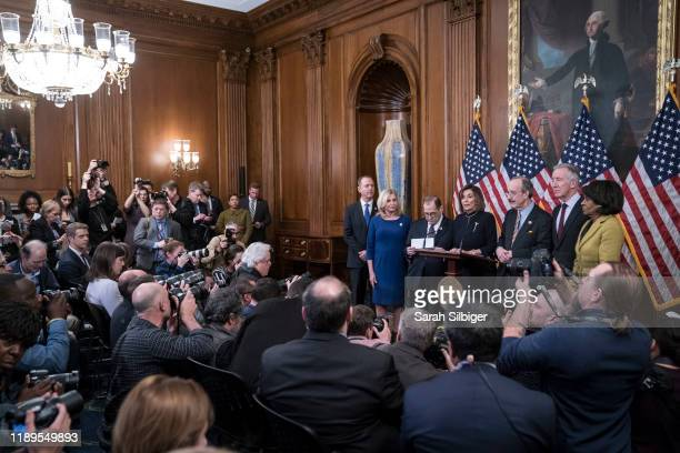 Speaker of the House Nancy Pelosi delivers remarks alongside Chairman Adam Schiff House Permanent Select Committee on Intelligence Chairwoman Carolyn...