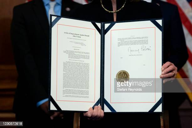 Speaker of the House Nancy Pelosi displayed a signed article of impeachment against President Donald Trump at the U.S. Capitol on January 13, 2021 in...