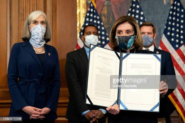 Speaker of the House Nancy Pelosi displays a signed article of impeachment against President Donald Trump at the U.S. Capitol on January 13, 2021 in...