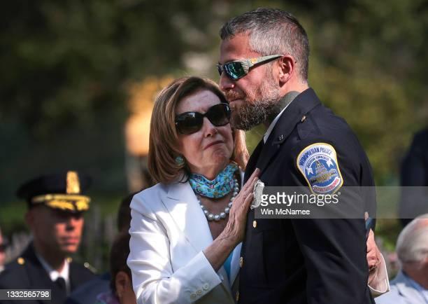 Speaker of the House Nancy Pelosi embraces DC Metropolitan Police Officer Michael Fanone at a ceremony where U.S. President Joe Biden will sign a...