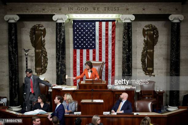 Speaker of the House Nancy Pelosi gavels the close of a vote by the U.S. House of Representatives on a resolution formalizing the impeachment inquiry...