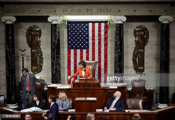 Speaker of the House Nancy Pelosi gavels the close of a vote by the US House of Representatives on a resolution formalizing the impeachment inquiry...