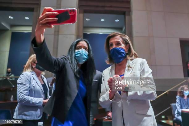 Speaker of the House Nancy Pelosi has a selfie taken with president of the Leadership Conference on Civil and Human Rights Vanita Gupta at the House...