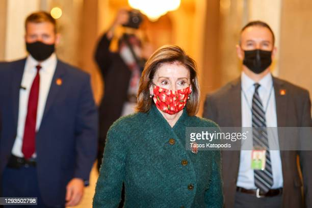 Speaker of the House Nancy Pelosi heads back to her office after she opened up the House floor on December 28, 2020 in Washington, DC. President...