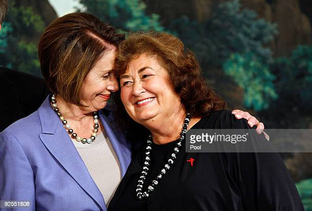 Speaker of the House Nancy Pelosi holds Ryan White's mother before President Barack Obama signs the Ryan White HIV/AIDS Treatment Extension Act of...