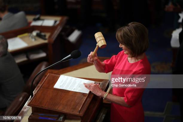Speaker of the House Nancy Pelosi holds the gavel during the first session of the 116th Congress at the US Capitol January 03 2019 in Washington DC...