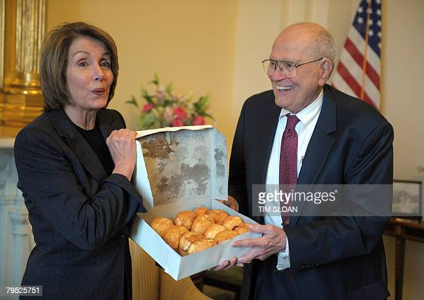US Speaker of the House Nancy Pelosi is given a box of paczki a traditional pastry commonly eaten on Fat Tuesday from the Chene Modern Bakery in...