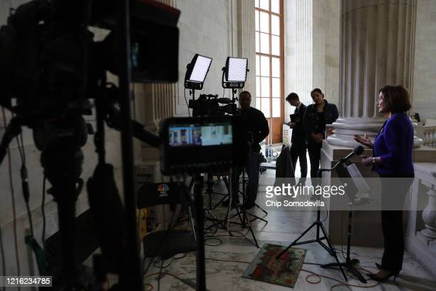 Speaker of the House Nancy Pelosi is interviewed by CNN about the government response to the ongoing global coronavirus pandemic in the rotunda of...