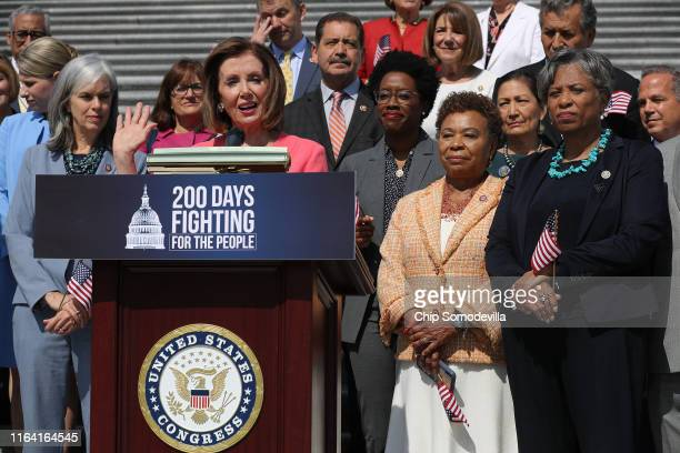 Speaker of the House Nancy Pelosi is joined by fellow House Democrats to mark the 200th day of the 116th Congress on the steps outside the US Capitol...