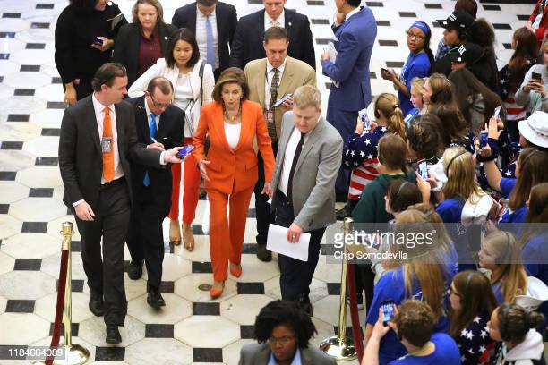 Speaker of the House Nancy Pelosi is surrounded by staff and journalists as she leaves the floor after the close of a vote by the US House of...