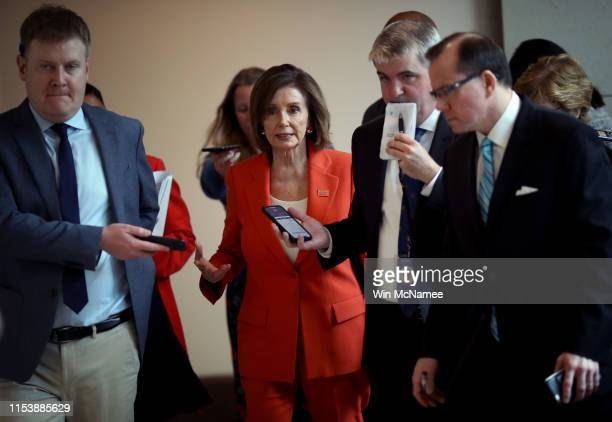 S Speaker of the House Nancy Pelosi is trailed by reporters following her weekly news conference at the US Capitol June 5 2019 in Washington DC...