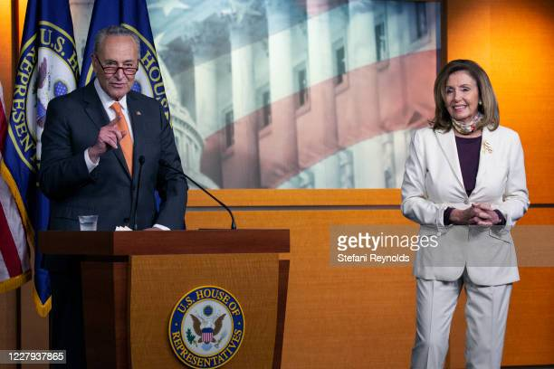 Speaker of the House Nancy Pelosi listens as Senate Minority Leader Charles Schumer speaks during a weekly news conference at the U.S. Capitol on...