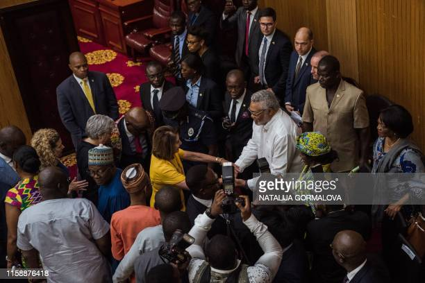 US Speaker of the House Nancy Pelosi meets with former president of Ghana Jeremiah John Rawlings and his wife Nana Konadu Agyeman Rawlings at the...