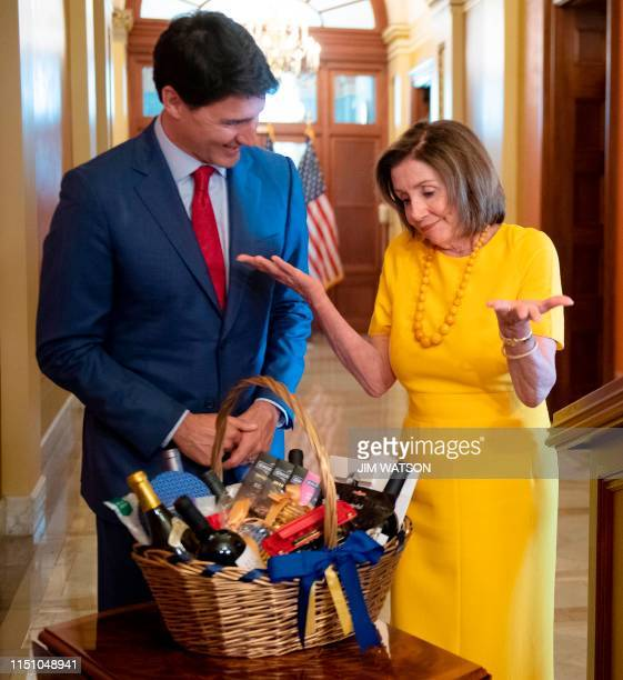 US Speaker of the House Nancy Pelosi pays her bet to Canadian Prime Minister Justin Trudeau on Capitol Hill in Washington DC on June 20 2019 Pelosi...