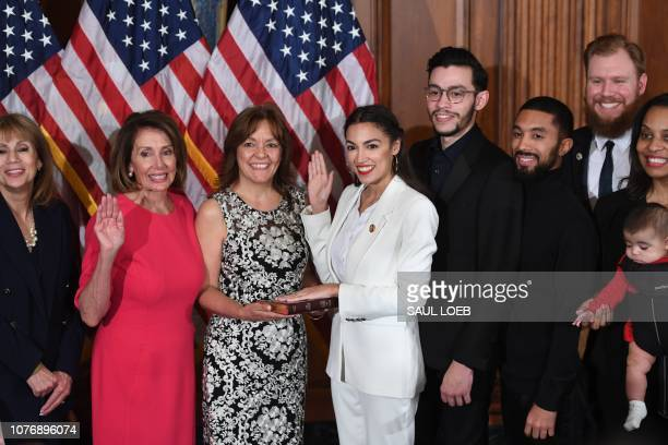 Speaker of the House Nancy Pelosi performs a ceremonial swearingin for US House Representative Alexandria OcasioCortez DNY and family at the start of...