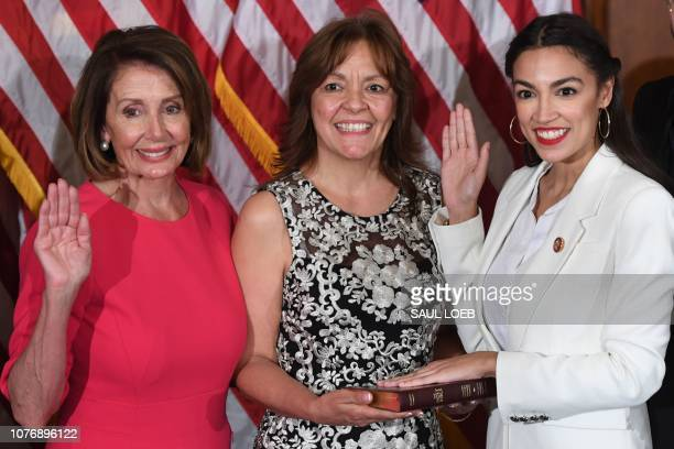 Speaker of the House Nancy Pelosi performs a ceremonial swearingin for US House Representative Alexandria OcasioCortez DNY at the start of the 116th...