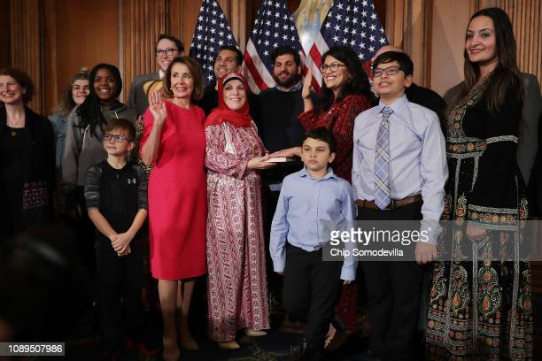 Speaker of the House Nancy Pelosi poses for photographs with Rep. Rashida Tlaib and her family in the Rayburn Room at the U.S. Capitol January 03,...