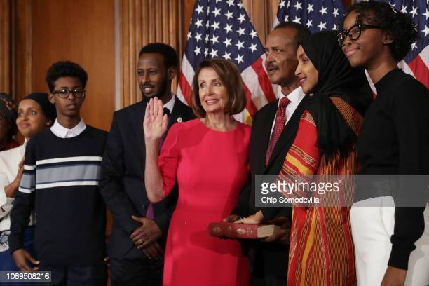 Speaker of the House Nancy Pelosi poses for photographs with Rep Ilhan Omar and her family in the Rayburn Room at the US Capitol January 03 2019 in...