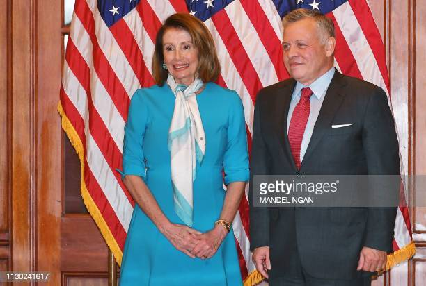 Speaker of the House Nancy Pelosi poses with Jordan's King Abdullah ahead of a meeting at the US Capitol in Washington, DC on March 13, 2019.