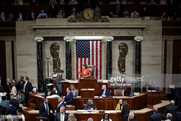 Speaker of the House Nancy Pelosi presides over a vote by the U.S. House of Representatives on a resolution formalizing the impeachment inquiry...