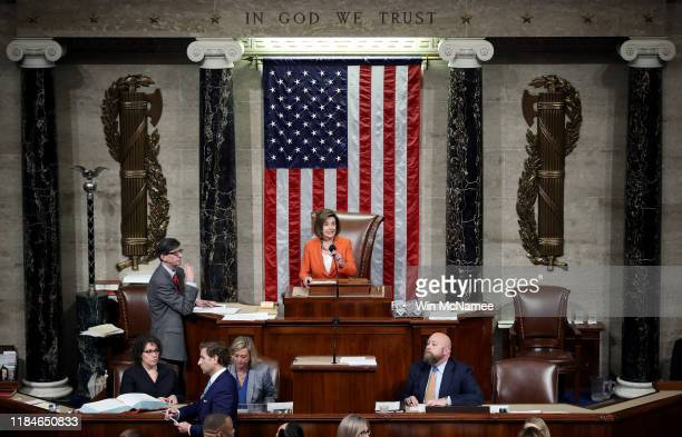 Speaker of the House Nancy Pelosi presides over a vote by the US House of Representatives on a resolution formalizing the impeachment inquiry...