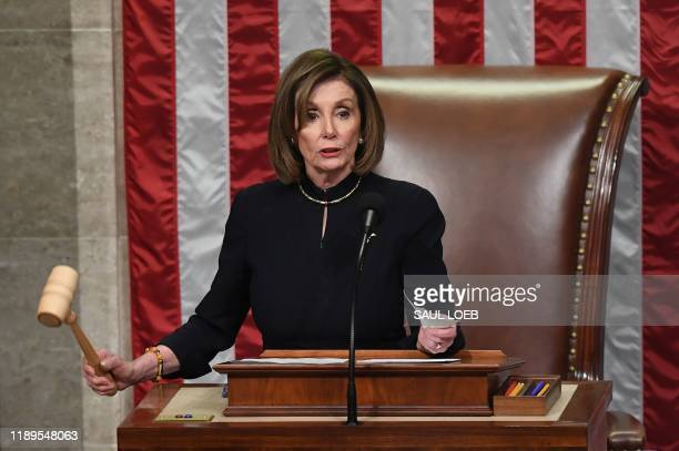 US Speaker of the House Nancy Pelosi presides over Resolution 755 Articles of Impeachment Against President Donald J Trump as the House votes at the...