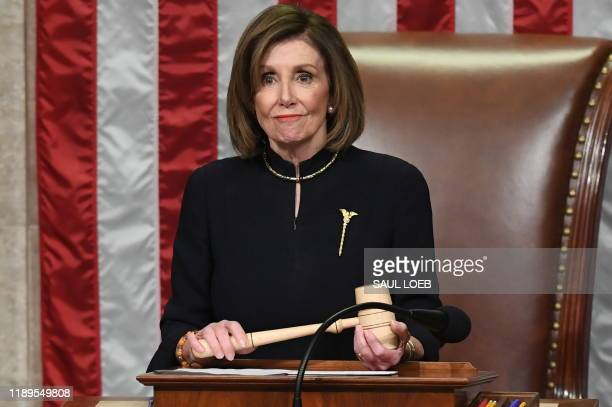 Speaker of the House Nancy Pelosi presides over Resolution 755 Articles of Impeachment Against President Donald J Trump as the House votes at the US...