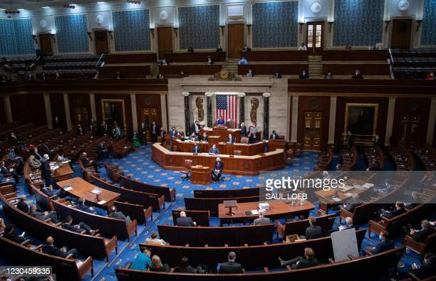 Speaker of the House Nancy Pelosi presides over the US House of Representatives after they reconvened following protests at the US Capitol in...