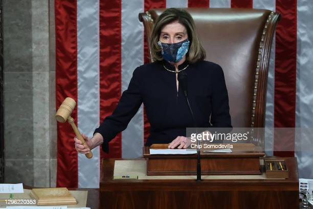 Speaker of the House Nancy Pelosi raps her gavel after the House voted to impeach U.S. President Donald Trump for the second time in little over a...