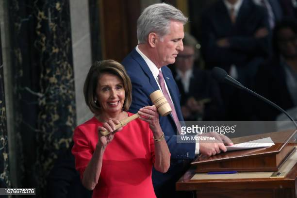Speaker of the House Nancy Pelosi receives the gavel from Rep Kevin McCarthy during the first session of the 116th Congress at the US Capitol January...