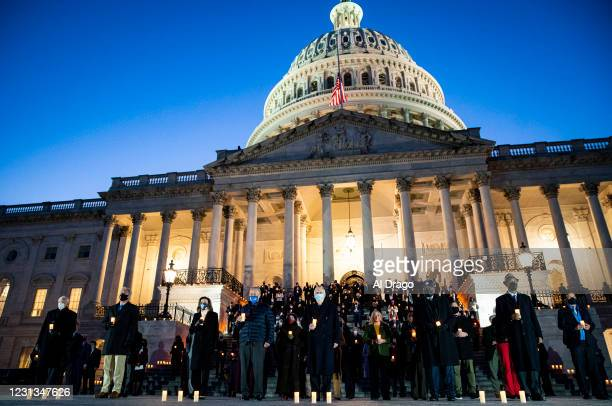 Speaker of the House Nancy Pelosi , Senate Majority Leader Charles Schumer and Senate Minority Leader Mitch McConnell join fellow members of Congress...