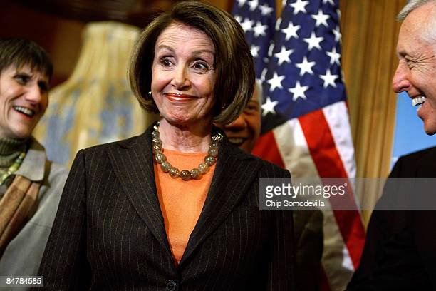 Speaker of the House Nancy Pelosi smiles during a news conference with House Majority Leader Steny Hoyer and Rep Rosa DeLauro in the US Capitol...