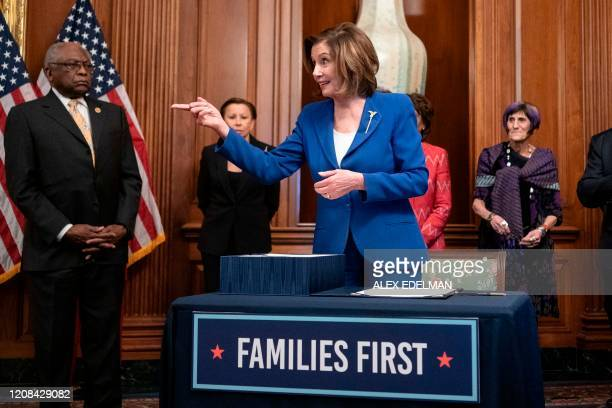 Speaker of the House Nancy Pelosi speaks after signing the bill after the House passed a $2 trillion stimulus bill, on March 27 at the US Capitol in...