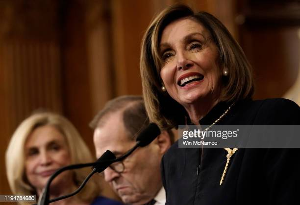 Speaker of the House Nancy Pelosi speaks at a press conference following the impeachment vote in the House of Representatives against US President...