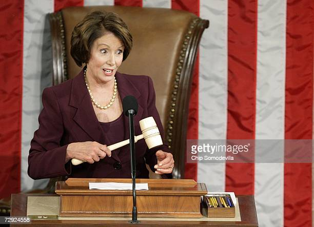 Speaker of the House Nancy Pelosi speaks while wielding the Speaker's gavel after being elected as the first woman Speaker during a swearing in...