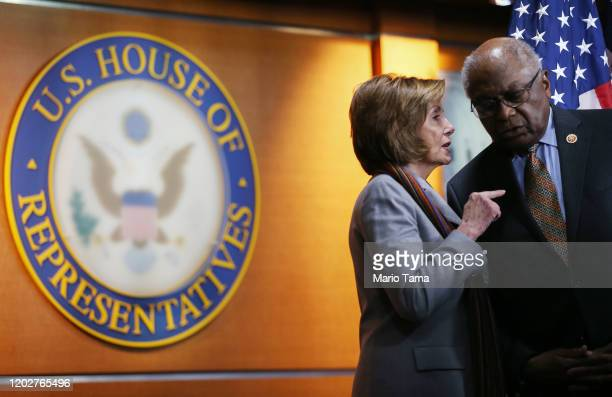 Speaker of the House Nancy Pelosi speaks with Rep Jim Clyburn at a news conference unveiling House Democrats' new infrastructure framework at the US...