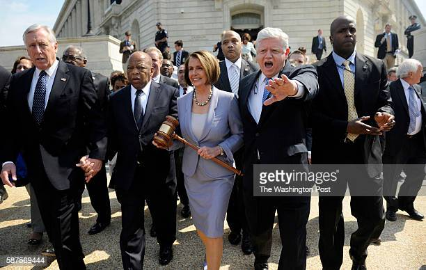 Speaker of the House Nancy Pelosi surrounded by leadership and arm and arm with Congressman John Lewis as they walked to the Capitol building on...