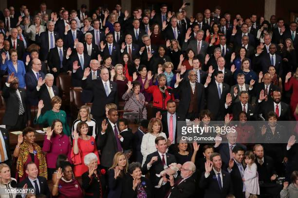 Speaker of the House Nancy Pelosi swears in House members during the first session of the 116th Congress at the US Capitol January 03 2019 in...