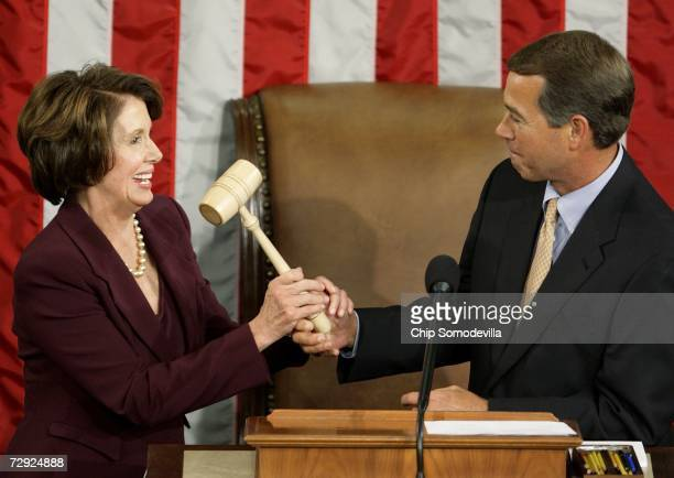Speaker of the House Nancy Pelosi takes the Speaker's gavel from House Minority Leader Rep John Boehner after being elected as the first woman...